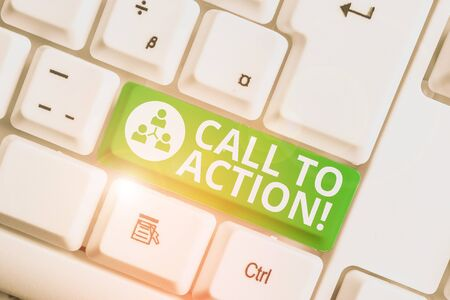Writing note showing Call To Action. Business concept for exhortation do something in order achieve aim with problem White pc keyboard with note paper above the white background