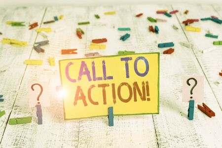 Text sign showing Call To Action. Business photo text exhortation do something in order achieve aim with problem Scribbled and crumbling sheet with paper clips placed on the wooden table Banco de Imagens