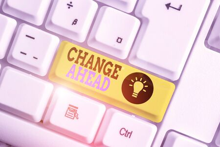 Text sign showing Change Ahead. Business photo showcasing to replace with or exchange for another Become different White pc keyboard with empty note paper above white background key copy space