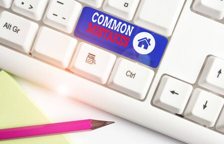 Handwriting text Common Mistakes. Conceptual photo actions that are often used interchangeably with error White pc keyboard with empty note paper above white background key copy space Stok Fotoğraf