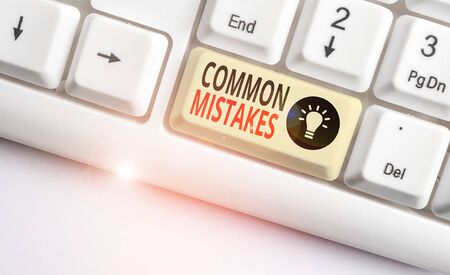 Word writing text Common Mistakes. Business photo showcasing actions that are often used interchangeably with error White pc keyboard with empty note paper above white background key copy space