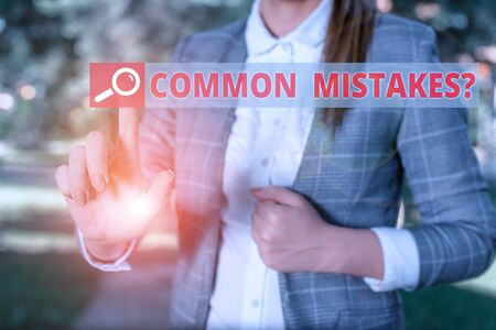 Handwriting text Common Mistakes Question. Conceptual photo repeat act or judgement misguided making something wrong Business woman in the nature pointing with the finger into empty space