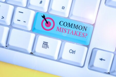Text sign showing Common Mistakes Question. Business photo showcasing repeat act or judgement misguided making something wrong White pc keyboard with empty note paper above white background key copy space Stok Fotoğraf