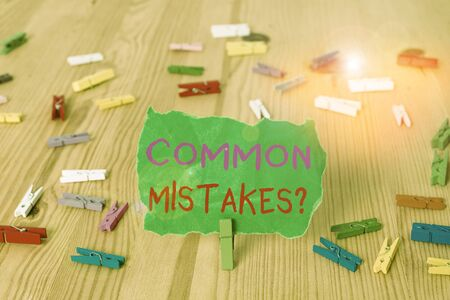 Word writing text Common Mistakes Question. Business photo showcasing repeat act or judgement misguided making something wrong Colored clothespin papers empty reminder wooden floor background office