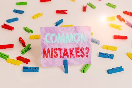 Writing note showing Common Mistakes Question. Business concept for repeat act or judgement misguided making something wrong Colored clothespin papers empty reminder white floor background office Reklamní fotografie