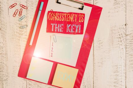 Handwriting text writing Consistency Is The Key. Conceptual photo by Breaking Bad Habits and Forming Good Ones Clipboard sheet crushed sticky note clip notepads marker wooden background Stok Fotoğraf