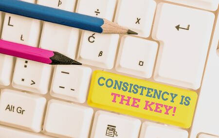 Word writing text Consistency Is The Key. Business photo showcasing by Breaking Bad Habits and Forming Good Ones White pc keyboard with empty note paper above white background key copy space