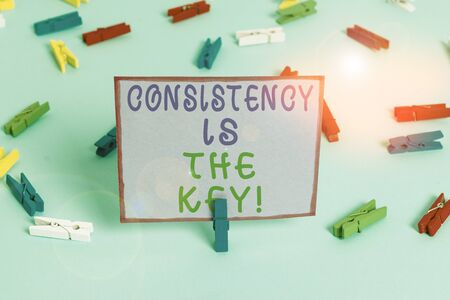 Writing note showing Consistency Is The Key. Business concept for by Breaking Bad Habits and Forming Good Ones Colored clothespin papers empty reminder blue floor officepin