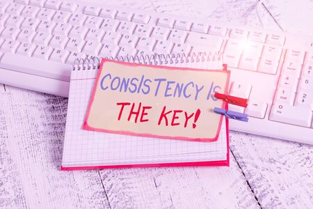 Writing note showing Consistency Is The Key. Business concept for by Breaking Bad Habits and Forming Good Ones notebook reminder clothespin with pinned sheet light wooden