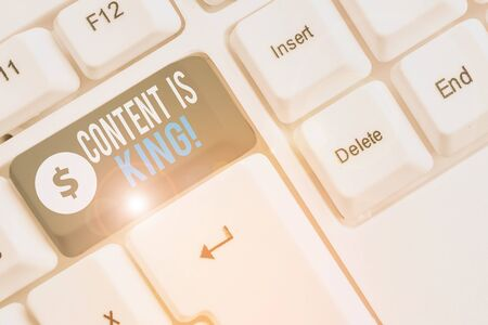 Text sign showing Content Is King. Business photo showcasing marketing focused growing visibility non paid search results White pc keyboard with empty note paper above white background key copy space Stok Fotoğraf
