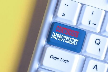 Text sign showing Continuous Improvement. Business photo showcasing ongoing effort to improve products or processes White pc keyboard with empty note paper above white background key copy space Stok Fotoğraf