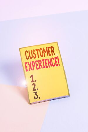 Word writing text Customer Experience. Business photo showcasing product of interaction between organization and buyer Paper placed tilted above buffer wire on soft pastel multi colours backdrop Stockfoto