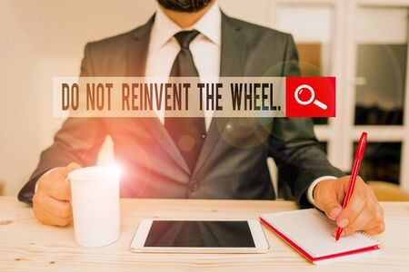 Word writing text Do Not Reinvent The Wheel. Business photo showcasing stop duplicating a basic method previously done Male human wear formal clothes present presentation use hi tech smartphone
