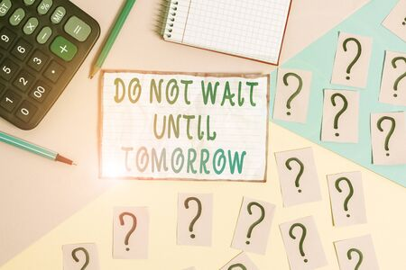 Handwriting text Do Not Wait Until Tomorrow. Conceptual photo needed to do it right away Urgent Better do now Mathematics stuff and writing equipment above pastel colours background Foto de archivo