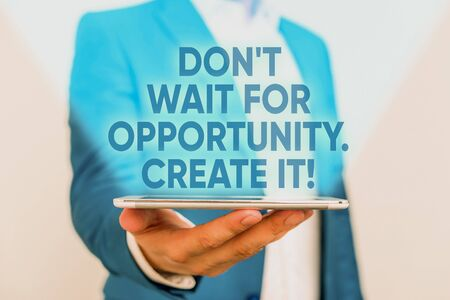 Writing note showing Don T Wait For Opportunity Create It. Business concept for work hard on yourself and begin from this moment Man in the blue suite and white shirt holds mobile phone in the hand