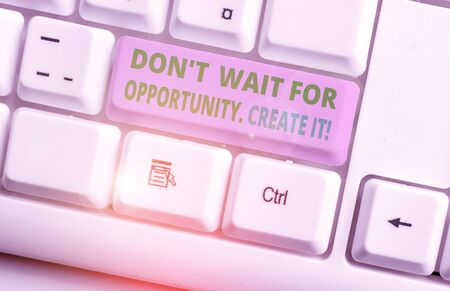 Conceptual hand writing showing Don T Wait For Opportunity Create It. Concept meaning work hard on yourself and begin from this moment White pc keyboard with note paper above the white background 写真素材