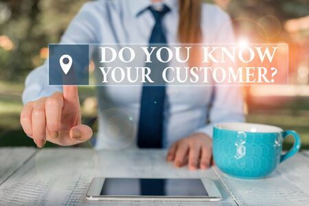 Conceptual hand writing showing Do You Know Your Customer Question. Concept meaning service identify clients with relevant information Female business person sitting and holding mobile phone