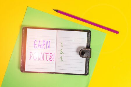 Text sign showing Earn Points. Business photo showcasing collecting scores in order qualify to win big prize Dark leather private locked diary striped sheets marker colored background Stockfoto