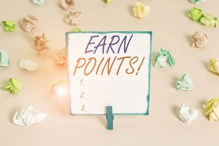 Handwriting text Earn Points. Conceptual photo collecting scores in order qualify to win big prize Colored crumpled papers empty reminder pink floor background clothespin