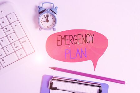 Word writing text Emergency Plan. Business photo showcasing procedures for handling sudden or unexpected situations Flat lay above table with clock pc keyboard and copy space note paper