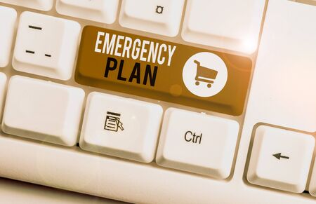 Word writing text Emergency Plan. Business photo showcasing procedures for handling sudden or unexpected situations White pc keyboard with empty note paper above white background key copy space