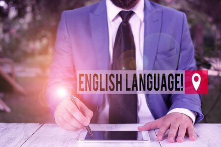 Word writing text English Language. Business photo showcasing third spoken native lang in world after Chinese and Spanish Businessman holds pen and points into copy space