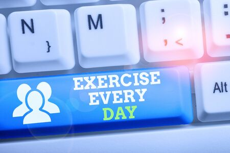 Conceptual hand writing showing Exercise Every Day. Concept meaning move body energetically in order to get fit and healthy Keyboard with note paper on white background key copy space