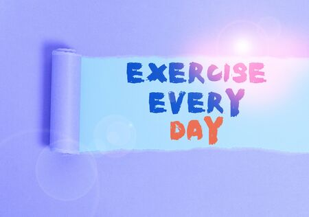 Handwriting text Exercise Every Day. Conceptual photo move body energetically in order to get fit and healthy Cardboard which is torn in the middle placed above a plain table backdrop