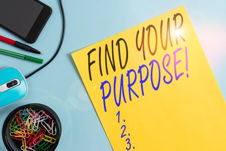 Writing note showing Find Your Purpose. Business concept for reason for something is done or for which still exists Notebook and stationary with gadgets above pastel backdrop Foto de archivo