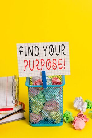 Conceptual hand writing showing Find Your Purpose. Concept meaning reason for something is done or for which still exists Trash bin crumpled paper clothespin office supplies yellow