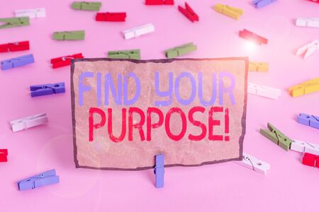 Handwriting text writing Find Your Purpose. Conceptual photo reason for something is done or for which still exists Colored clothespin papers empty reminder pink floor background office pin
