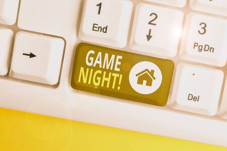 Handwriting text Game Night. Conceptual photo usually its called on adult play dates like poker with friends White pc keyboard with empty note paper above white background key copy space Foto de archivo