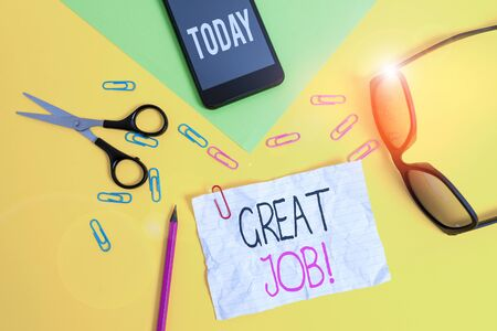 Conceptual hand writing showing Great Job. Concept meaning sed for telling someone that they have done something well Paper sheets smartphone scissors eyeglasses colored background