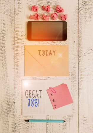 Handwriting text writing Great Job. Conceptual photo sed for telling someone that they have done something well Envelop smartphone notepad note clip marker paper balls wooden background