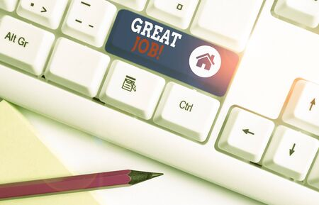 Handwriting text Great Job. Conceptual photo sed for telling someone that they have done something well White pc keyboard with empty note paper above white background key copy space Imagens
