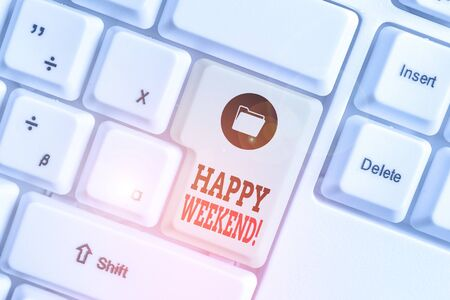 Text sign showing Happy Weekend. Business photo showcasing something nice has happened or they feel satisfied with life White pc keyboard with empty note paper above white background key copy space Фото со стока