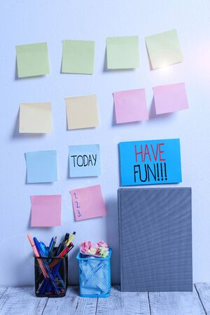 Conceptual hand writing showing Have Fun. Concept meaning wish somebody good and enjoyable time when they do something Sticky Notes Card on Wall Pencil Pots Notebook on Work Desk