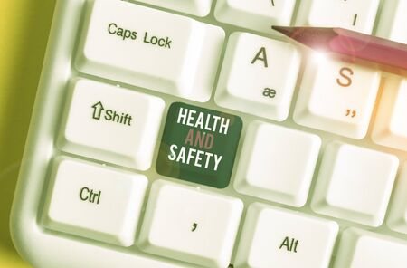 Word writing text Health And Safety. Business photo showcasing procedures intended to prevent accident in workplace White pc keyboard with empty note paper above white background key copy space