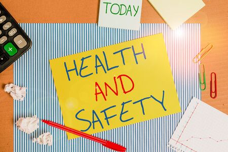 Word writing text Health And Safety. Business photo showcasing procedures intended to prevent accident in workplace Striped paperboard notebook cardboard office study supplies chart paper