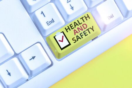 Text sign showing Health And Safety. Business photo showcasing procedures intended to prevent accident in workplace White pc keyboard with empty note paper above white background key copy space 스톡 콘텐츠
