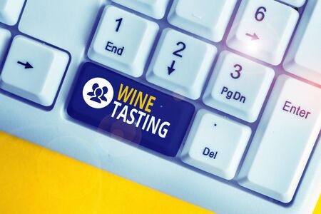 Word writing text Wine Tasting. Business photo showcasing Degustation Alcohol Social gathering Gourmet Winery Drinking White pc keyboard with empty note paper above white background key copy space