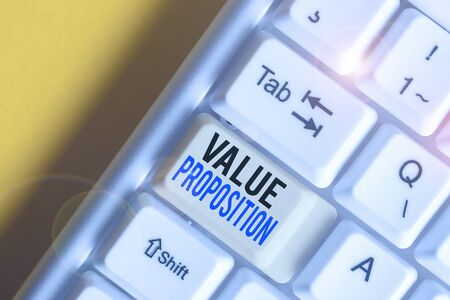 Writing note showing Value Proposition. Business concept for feature intended to make a company or product attractive White pc keyboard with note paper above the white background