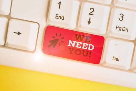 Writing note showing We Need You. Business concept for to fulfill the needs of the assignment duty or obligation White pc keyboard with note paper above the white background