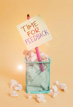 Writing note showing Time For Feedback. Business concept for information about reactions to a product or services crumpled paper and stationary with paper placed in the trash can