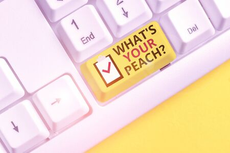 Text sign showing What S Is Your Peach question. Business photo showcasing an exceptionally good demonstrating or thing White pc keyboard with empty note paper above white background key copy space