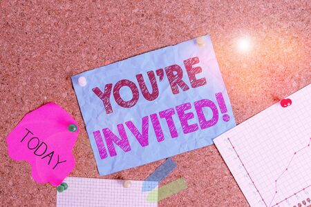Conceptual hand writing showing You Re Invited. Concept meaning make a polite friendly request to someone go somewhere Corkboard size paper thumbtack sheet billboard notice board