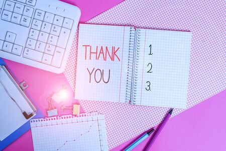 Word writing text Thank You. Business photo showcasing a polite expression used when acknowledging a gift or service Writing equipments and computer stuffs placed above colored plain table Stockfoto