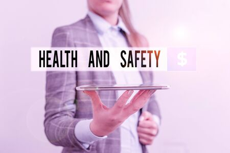 Conceptual hand writing showing Health And Safety question. Concept meaning regulations and procedures intended to prevent accident Business concept with mobile phone and business woman