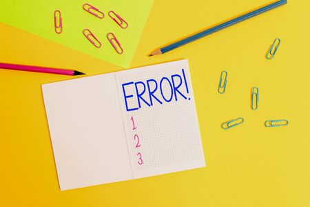 Writing note showing Error. Business concept for state or condition of being wrong in conduct judgement or program Blank squared notebook pencils markers paper sheet colored background