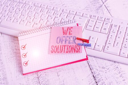 Writing note showing We Offer Solutions. Business concept for way to solve problem or deal with difficult situation notebook reminder clothespin with pinned sheet light wooden